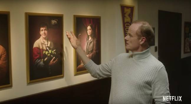 Mr Groff examines portraits of the Moordale students (Credit: Netflix)