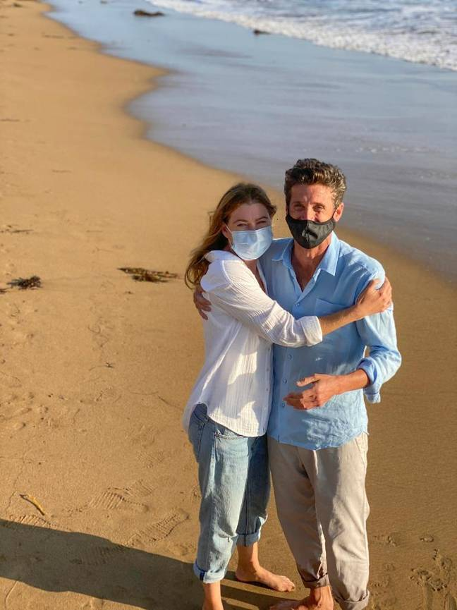 Patrick Dempsey and Ellen Pompeo filming on the beach (Credit: ABC)