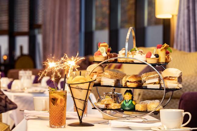 The afternoon tea includes Derry sausage roll baps, cream horns, cones of chips and Tayto crisp sandwiches (Credit: Hastings Everglades Hotel)