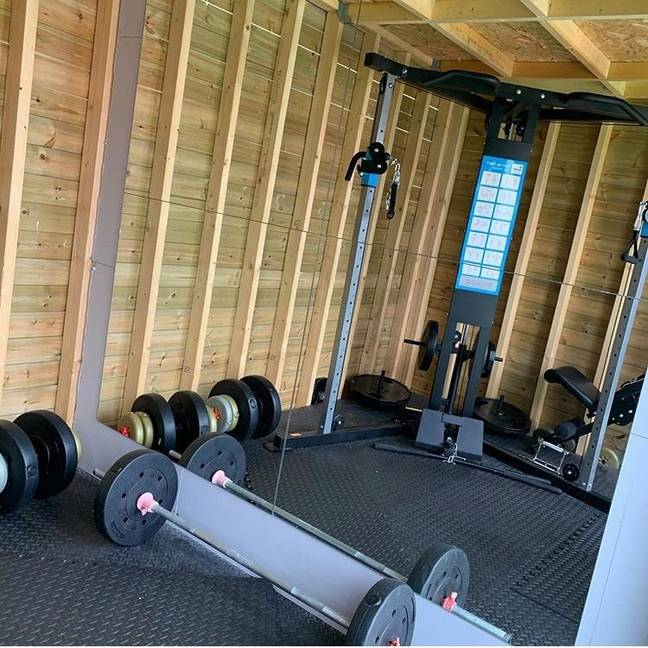 The finished gym is complete with a mirrored wall, weights and gym mats (Credit: Latestdeals.co.uk)