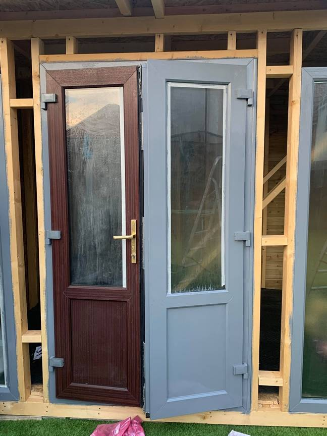 The couple used doors from a local scrapyard and painted them smoke grey (Credit: Latestdeals.co.uk)