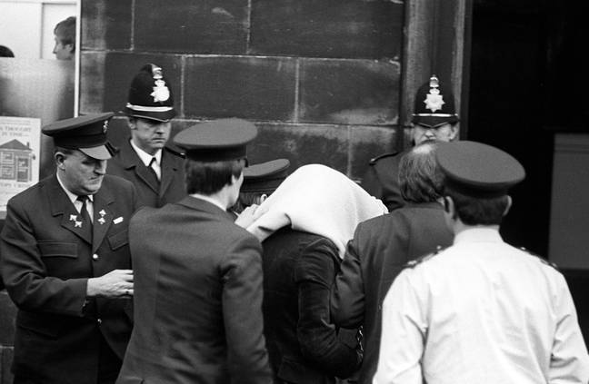Peter Sutcliffe, under a blanket, arriving at Dewsbury Magistrates Court. (Credit: PA)