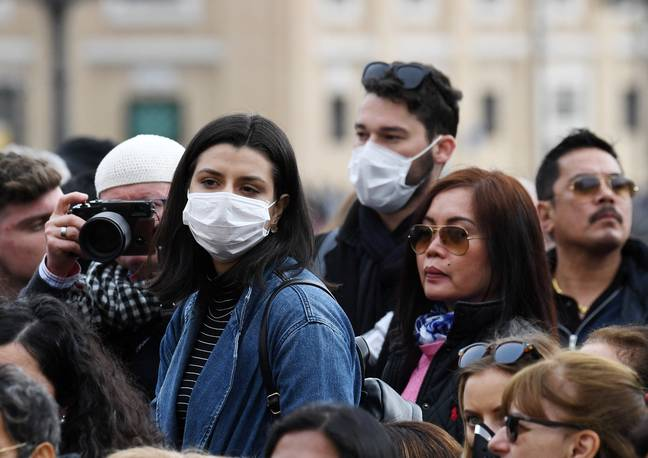 People wearing face masks in Italy (Credit: PA)