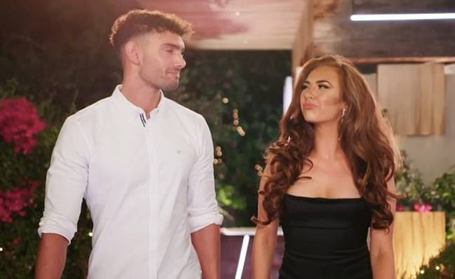 Wallace and Demi smirk as they arrive in the villa (Credit: ITV)