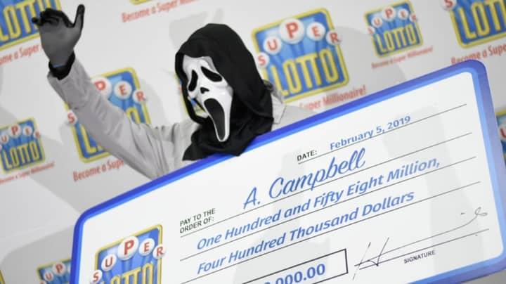 Jamaican Lottery Winner Wears Full 'Scream' Costumer To Claim Cheque