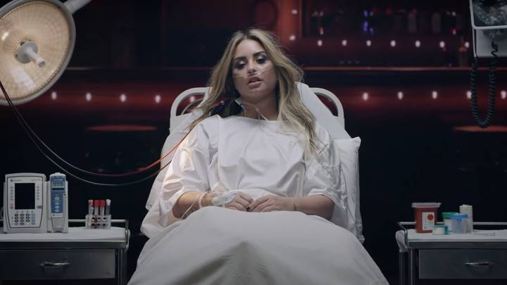 Demi Lovato Relives Overdose In New Music Video 'Dancing With The Devil'