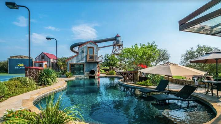 This Amazing Holiday Home Has Its Own Four-Storey Water Slide And Huge Pool