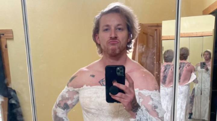 People Are Losing It As Man Models Ex's Wedding Dress To Sell It
