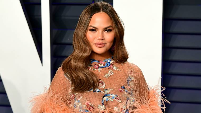 Chrissy Teigen Responds To Cruel Troll Who Accuses Her Of 'Using' Her Pregnancy Loss