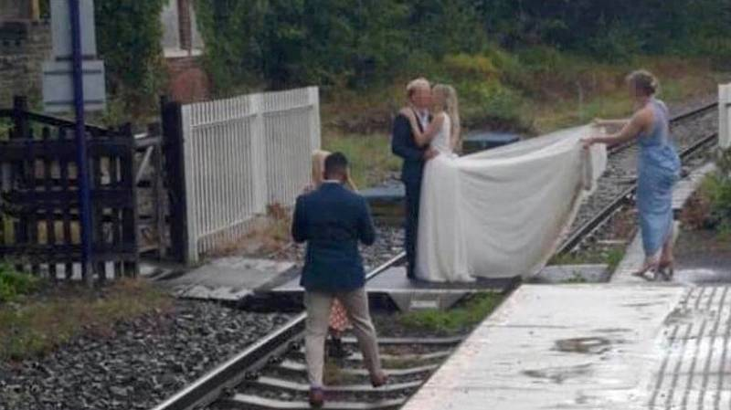 Bride And Groom Caught Trespassing On Railway Track For Wedding Pictures