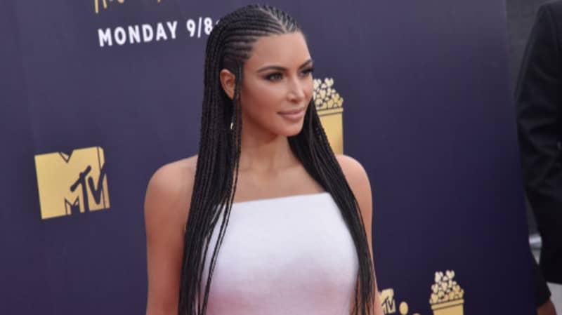 Kim Kardashian Flaunts Glowing Neck Implants On Instagram Story