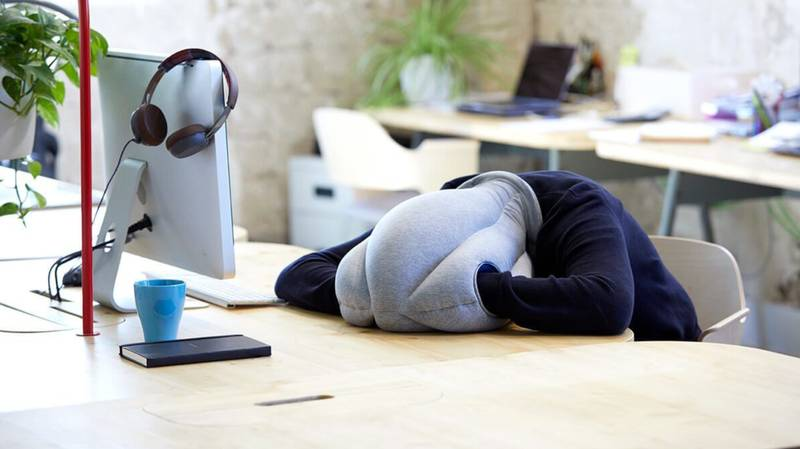 This Clever 'Ostrich' Pillow Lets You Take A Nap Whenever You Want In The Office