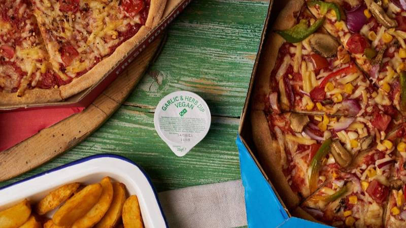 PSA: People Are Calling Domino's New Vegan Garlic And Herb Dip A 'Game Changer'