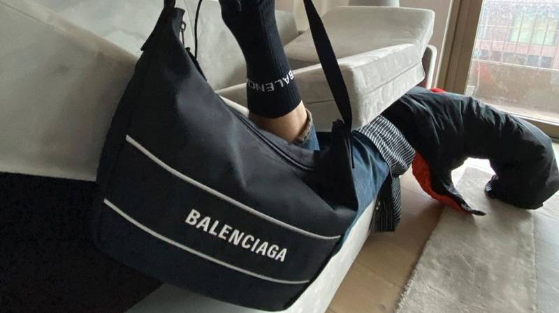 Balenciaga Ridiculed For This Bizarre Bag And Shoe Photoshoot With Model Sandwiched In Sofa